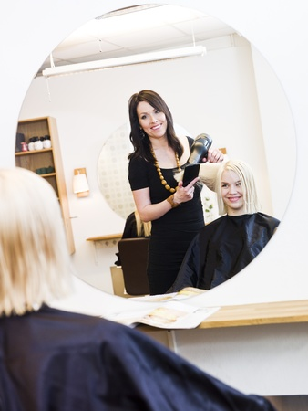 Hairdresser in action with blond customer Stock Photo - 9288970
