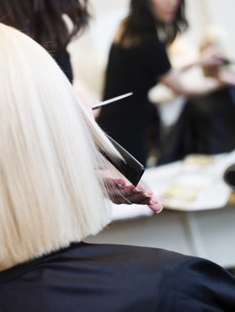 haircutting scissors: Close up of a scissor in action at the Hair Salon