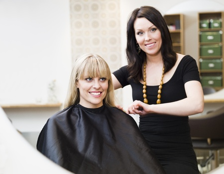 Hairdresser in action with blond customer Stock Photo - 9289013