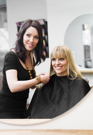 Hairdresser in action with blond customer Stock Photo - 9289011