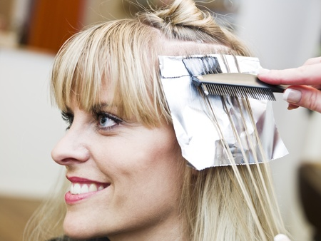 Blond woman at the Hair Salon photo