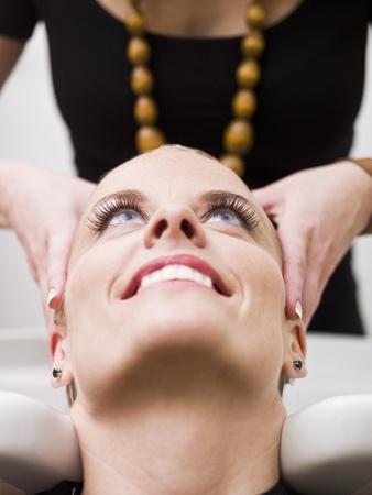 Woman washing at the hair salon photo