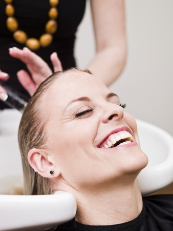 Laughing woman relaxing at the Beauty spa photo