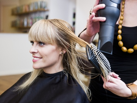 human hair: Blond woman at the Hair Salon