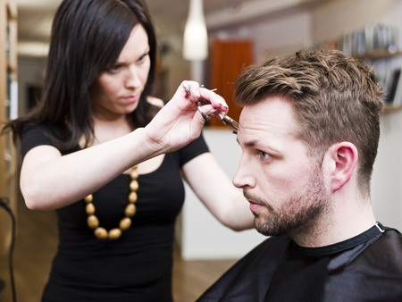 hairdresser cutting hair: Man at the Hair salon situation Stock Photo