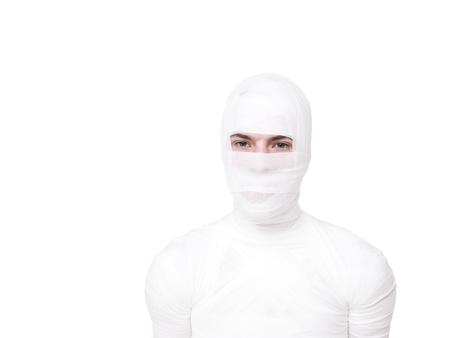 mummified: Mummified young Man isolated on white background