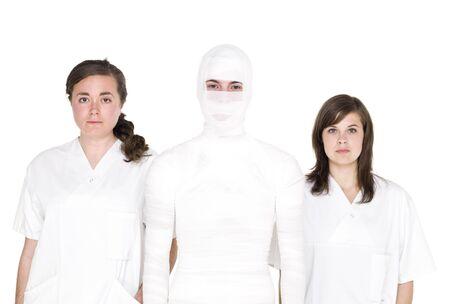 mummified: Mummified person with two female nurses Stock Photo