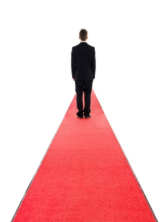 red carpet background: Man from behind on a red carpet isolated on white background