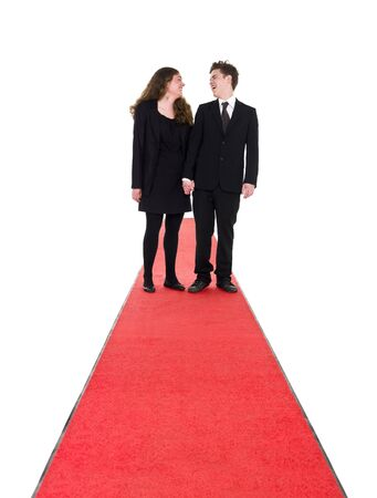 full red: Couple standing on a red carpet isolated on white background Stock Photo