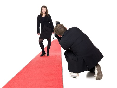 Photographer taking pictures on a woman posing on a red carpet Stock Photo - 9459346