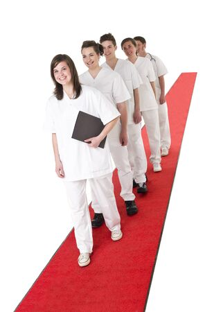 rounds: Medical Team on a red Carpet isolated on white background Stock Photo
