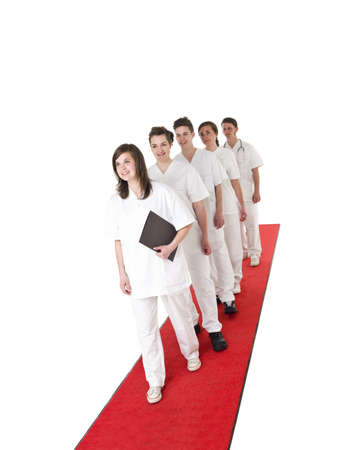 rounds: Doctor and Nurses on a red carpet isolated on white background Stock Photo