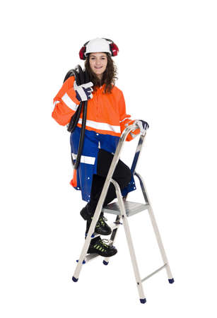 female construction worker: Female Construction Worker climbing a step ladder isolated on white background