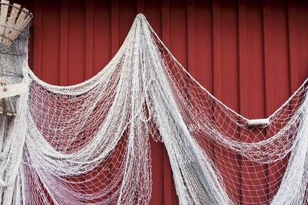 Fishing net hanging on a wall