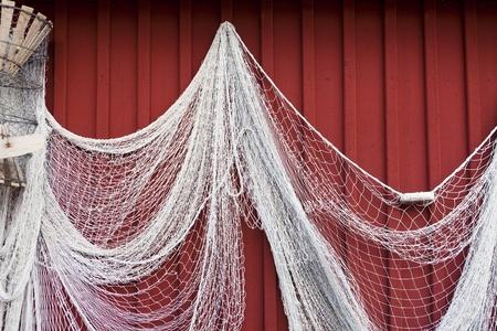 fishing net: Fishing net hanging on a wall