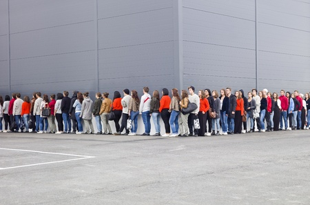 Large group of people waiting in line photo
