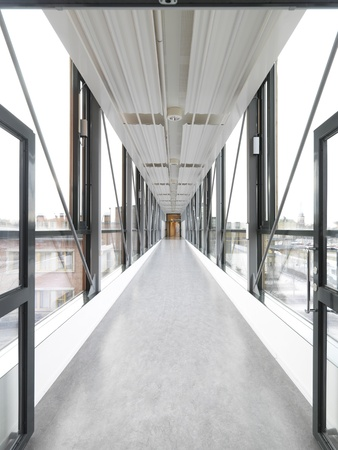 Glass corridor with modern architecture
