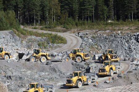 sand quarry: Group of Trucks at a Construction Site Editorial
