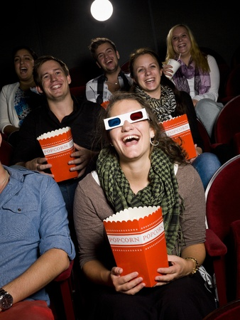 Laughing woman at the movie theater Stock Photo - 10740730