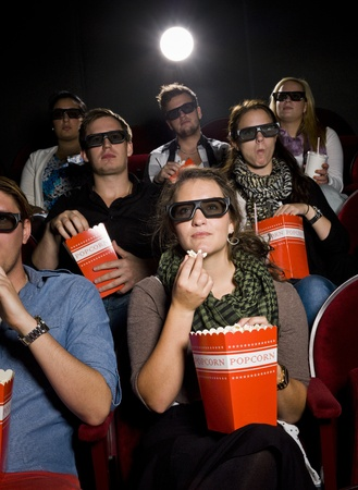intoxicating: Spectators eating popcorn at the movie theater