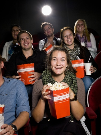 Movie theater: Spectators eating popcorn at the movie theater