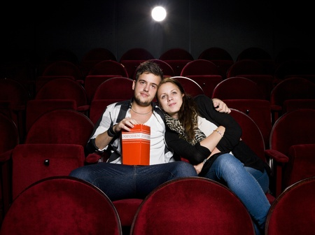 first date: Young couple alone at the Movie Theater Stock Photo