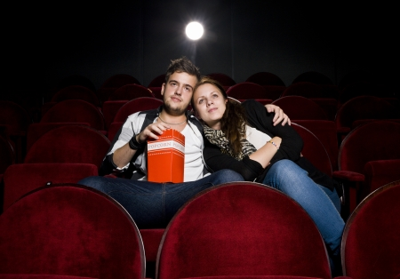 Young couple alone at the Movie Theater photo