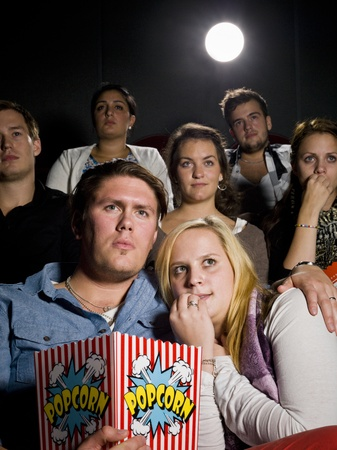 theater audience: Young couple on a date at the movie theater