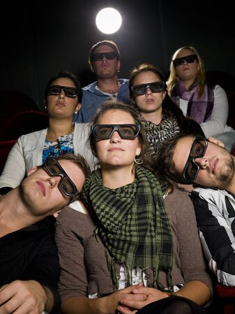 Spectators with 3d glasses on the movie theater photo