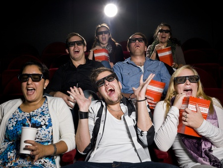 3d scary: Scared Movie spectators with 3d glasses Stock Photo