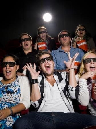 funny movies: Scared Movie spectators with 3d glasses Stock Photo