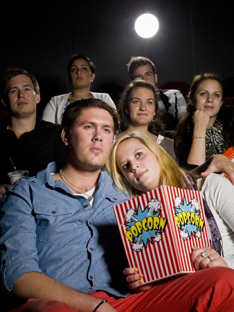 Young couple on a date at the movie theater photo