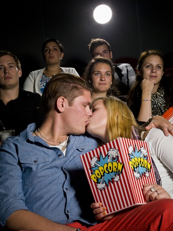 intoxicating: Young couple on a date at the movie theater