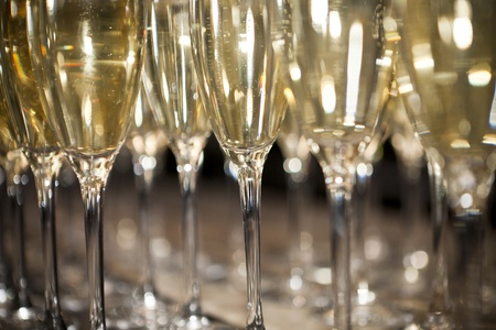 gold flute: Close up of glasses with Sparkling Champagne Stock Photo