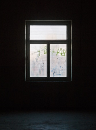 bad condition: Window with bad condition in a worn dark building
