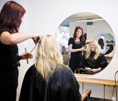 cutting hair: Situation in a Hair Salon Stock Photo