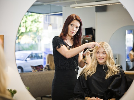 two stroke: Situation in a Hair Salon Stock Photo
