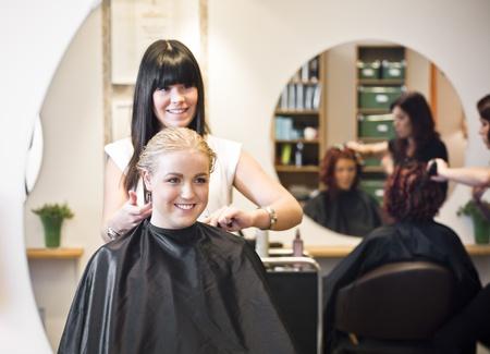 hairdresser cutting hair: Situation in a Hair Salon Stock Photo