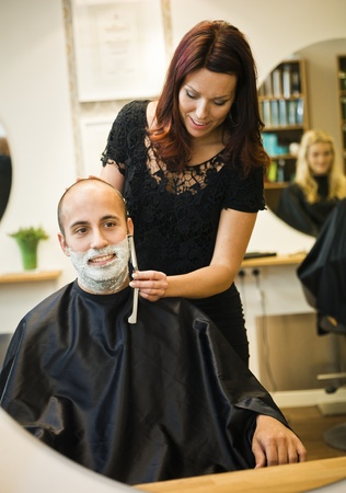 barber shave: Shaving situation at the hair salon Stock Photo
