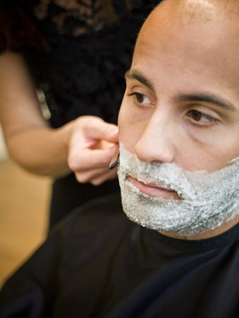 Shaving situation at the hair salon close-up photo