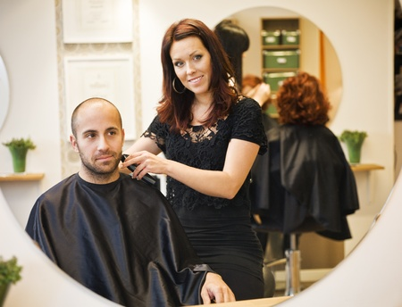 Adult man being shaved at the hair salon Stock Photo - 11223860