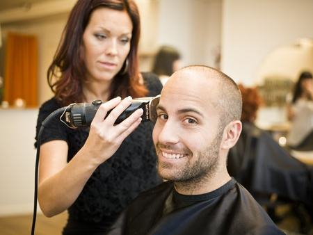 Adult man being shaved at the hair salon Stock Photo - 11223848