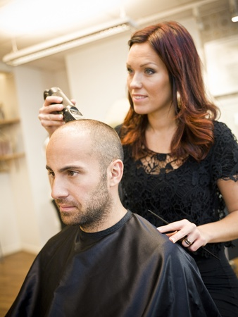 electric razor: Adult man being shaved at the hair salon