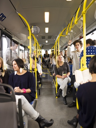 commuter: Large group of People going by bus