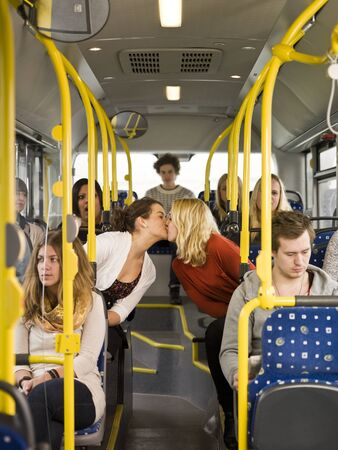 Kissing women on the bus photo
