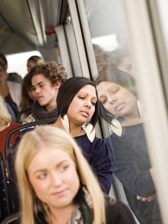 commuter: Woman sleeping while going by the bus