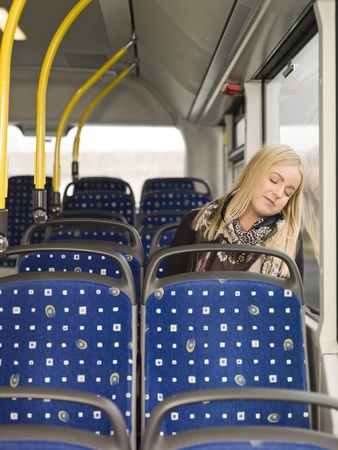Young woman sleeping on the bus photo