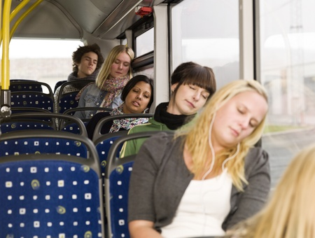 asleep chair: Group of young sleeping people on the bus