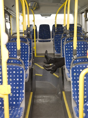 Anonymous person sleeps on the bus photo