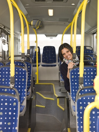 Happy woman alone on the bus photo
